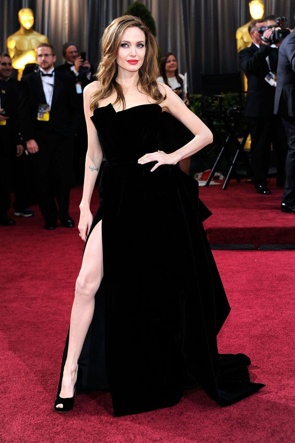 """<p>The dress that spawned a million memes. Angeline Jolie's strong stance in her Atelier Versace gown with her left leg became known as """"Angie leg.""""</p>"""