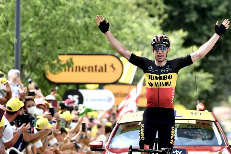 Playing to the crowd: Wout van Aert milked the applause as he won stage 11