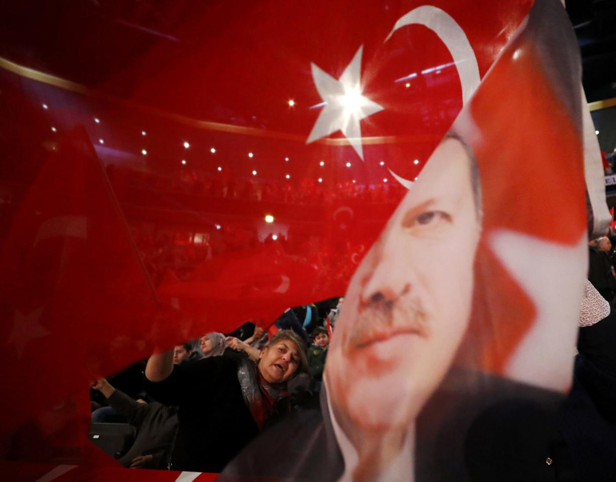People wave with flags showing Turkish President Recep Tayyip Erdogan before Turkish Prime Minister Binali Yildirim is expected to address a crowd of around 10,000 in Oberhausen, Germany, February 18, 2017, to promote Turkey's constitution referendum on April 16, 2017.      REUTERS/Wolfgang Rattay     TPX IMAGES OF THE DAY