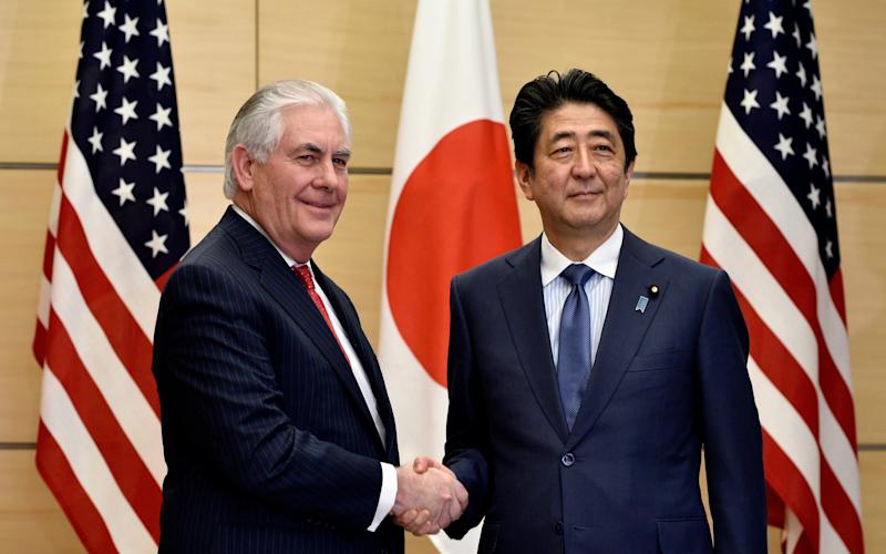 Rex Tillerson and Japanese prime minister Shinzo Abe in Tokyo this week - Credit: EPA