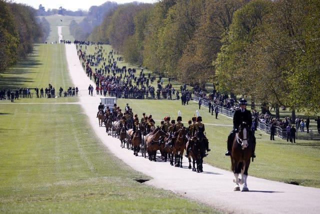 The Kings Troop Royal Horse Artillery make their way up The Long Walk