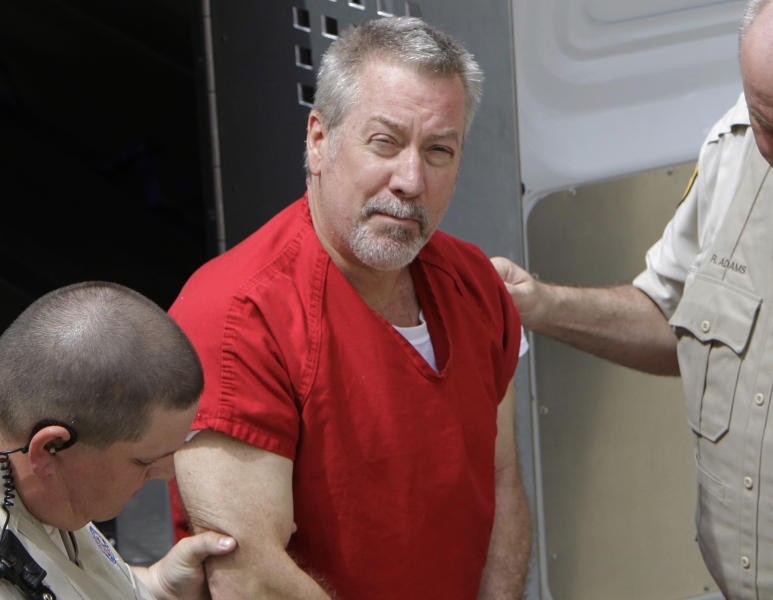 FILE - In this May 8, 2009 file photo, former Bolingbrook, Ill., police sergeant Drew Peterson arrives at the Will County Courthouse in Joliet, Ill., for his arraignment on charges of first-degree murder in the 2004 death of his former wife Kathleen Savio, who was found in an empty bathtub at home. Peterson's wisecracking, limelight-hogging, sunglasses-wearing lawyers faced the media horde every day of the former suburban Chicago police officer's 2012 trial — one that ended with a murder conviction and a falling out among the erstwhile colleagues. But the lawyerly war of words in public between lead trial counsel Joel Brodsky and former partner-turned-nemesis Steve Greenberg that began within hours of the trial's end will come to a head Tuesday, Feb. 19, 2013 at a hearing where the defense will argue Peterson deserves a new trial because Brodsky did a shoddy job. (AP Photo/M. Spencer Green, File)