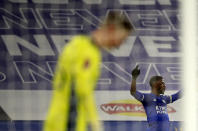 Leicester's Kelechi Iheanacho, right, celebrates after scoring his side's third goal during the English FA Cup quarter final soccer match between Leicester City and Manchester United at the King Power Stadium in Leicester, England, Sunday, March 21, 2021. (AP Photo/Ian Walton, Pool)
