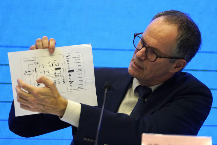 FILE - In this Feb. 9, 2021, file photo, Peter Ben Embarek of the World Health Organization team holds up a chart showing pathways of transmission of the virus during a joint news conference at the end of the WHO mission in Wuhan in central China's Hubei province. As the World Health Organization draws up plans for the next phase of its probe of how the coronavirus pandemic started, an increasing number of scientists say the U.N. agency it isn't up to the task and shouldn't be the one to investigate. (AP Photo/Ng Han Guan, File)