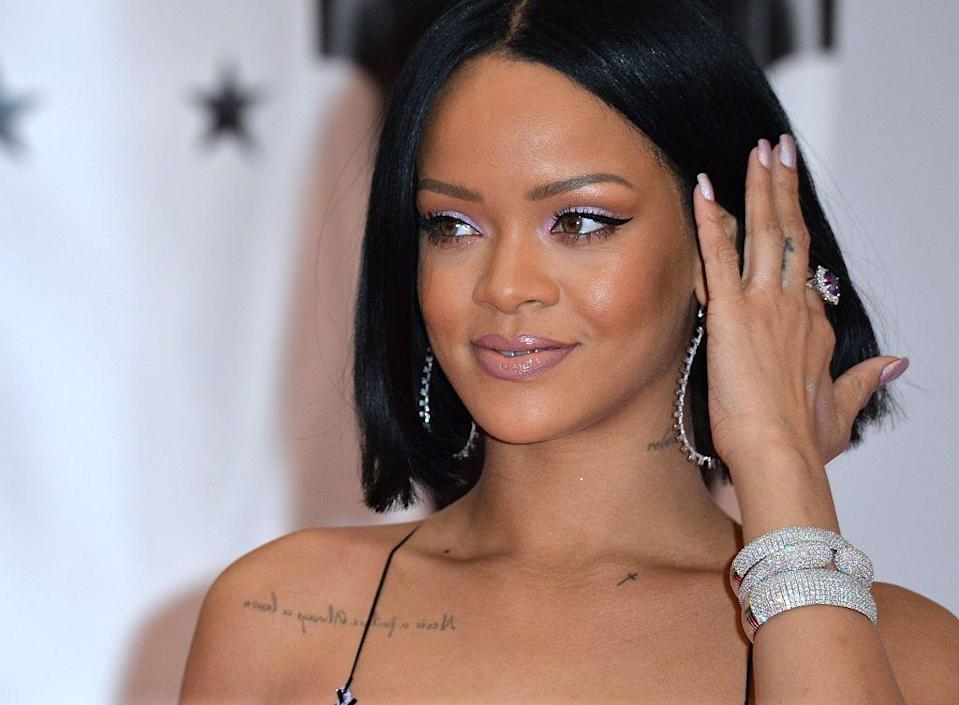 """<p>On her right shoulder blade, Rihanna has the phrase 'Never failure, always a lesson,' which was transcribed in mirrored writing so she can read it back to herself. Speaking after getting the tattoo in 2009, she told <a href=""""https://www.accessonline.com/articles/rihanna-shows-off-her-new-inspirational-ink-79722"""" rel=""""nofollow noopener"""" target=""""_blank"""" data-ylk=""""slk:Access Hollywood:"""" class=""""link rapid-noclick-resp"""">Access Hollywood:</a> 'That's my motto for life... I did it backwards so I could read it to myself in the mirror.'<br><br>Rihanna also has a small Christian crucifix cross inked to the right of the writing.</p>"""