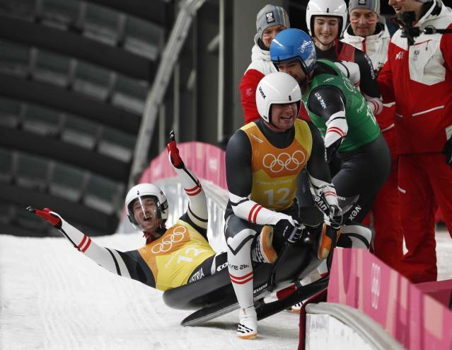 Luge - Pyeongchang 2018 Winter Olympic Games - Team Relay - Pyeongchang, South Korea - February 15, 2018 - The Austria team celebrate. REUTERS/Edgar Su