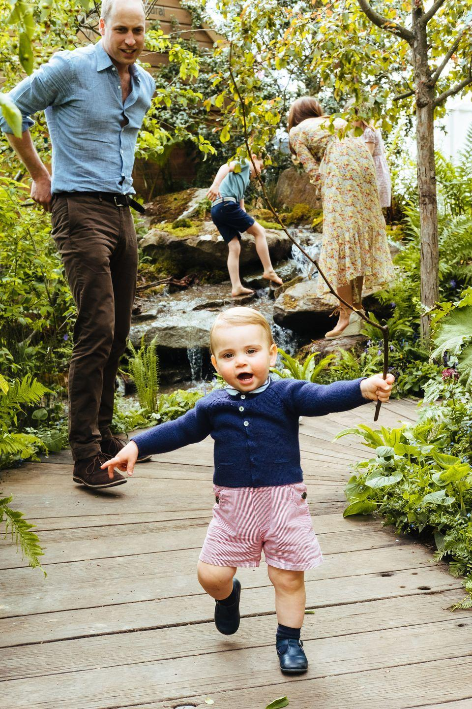 "<p>Prince Louis is walking! The little royal showed off his confident stride <a href=""https://www.townandcountrymag.com/society/tradition/a27520757/kate-middleton-william-george-charlotte-louis-photos-chelsea-flower-show/"" rel=""nofollow noopener"" target=""_blank"" data-ylk=""slk:at the Chelsea Flower Show"" class=""link rapid-noclick-resp"">at the Chelsea Flower Show</a>, where he and his siblings visited the garden designed by the Duchess of Cambridge. Prince William looked on at Louis headed towards the camera. </p>"