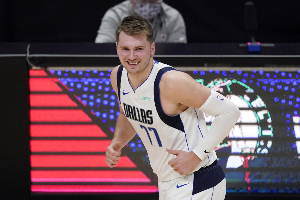 Dallas Mavericks guard Luka Doncic smiles after scoring during the first half in Game 1 of an NBA basketball first-round playoff series against the Los Angeles Clippers Saturday, May 22, 2021, in Los Angeles. (AP Photo/Mark J. Terrill)