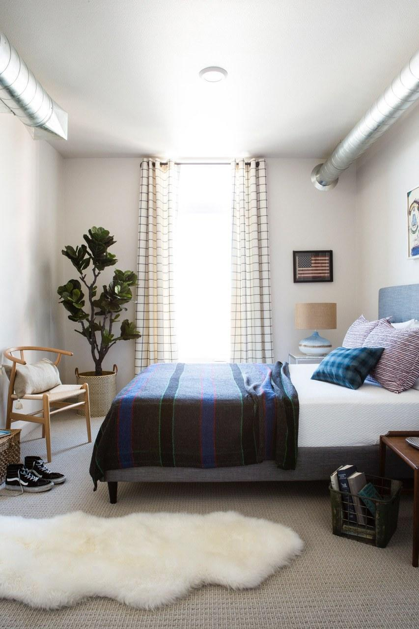 """<div class=""""caption""""> Max added height with gingham curtains in this master bedroom. </div> <cite class=""""credit"""">Photo: Christopher Dibble for Max Humphrey Interior Design</cite>"""