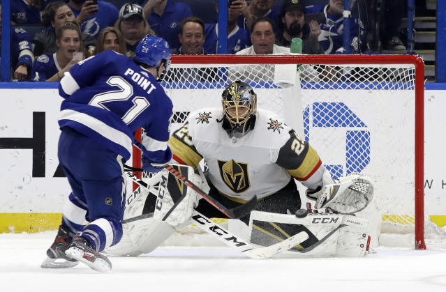 Vegas Golden Knights goaltender Marc-Andre Fleury (29) stops a shot by Tampa Bay Lightning center Brayden Point (21) during a shootout in an NHL hockey game Tuesday, Feb. 5, 2019, in Tampa, Fla. (AP Photo/Chris O'Meara)