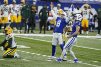 Indianapolis Colts kicker Rodrigo Blankenship (3) and Rigoberto Sanchez (8) celebrate a game-winning field goal by Blankenship during overtime of an NFL football game against the Green Bay Packers, Sunday, Nov. 22, 2020, in Indianapolis. (AP Photo/Michael Conroy)