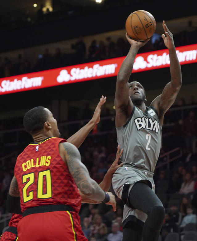 Brooklyn Nets Taurean Prince shoots past Atlanta Hawks John Collins (20) in the first half of an NBA basketball game Friday, Feb. 28, 2020, in Atlanta. (AP Photo/Tami Chappell)