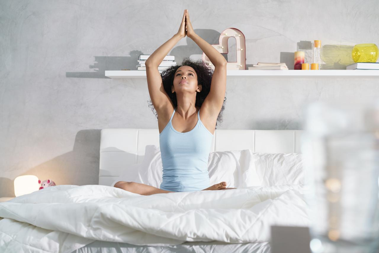 <p>A little stretching before bed can definitely promote sleep. Just 15 minutes can be enough to calm the mind and body. Give Yin yoga, a slow-paced style, a go if you're after ideas. Photo: Getty </p>