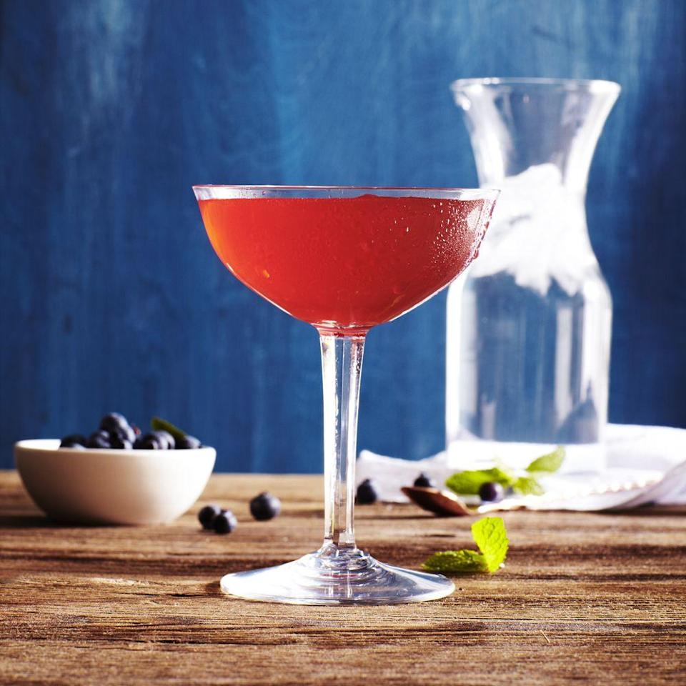 """<p>No party is complete without a signature drink! Bring out the shaker so you can whip up this blueberry-gin one for guests. </p><p><a href=""""https://www.goodhousekeeping.com/food-recipes/a33644/east-bayside-cocktail/"""" rel=""""nofollow noopener"""" target=""""_blank"""" data-ylk=""""slk:Get the recipe for East Bayside Cocktail »"""" class=""""link rapid-noclick-resp""""><em>Get the recipe for East Bayside Cocktail »</em></a></p><p><strong>RELATED: </strong><a href=""""https://www.goodhousekeeping.com/holidays/tips/g3620/summer-party/"""" rel=""""nofollow noopener"""" target=""""_blank"""" data-ylk=""""slk:60 Genius Summer Party Ideas for Easy Entertaining"""" class=""""link rapid-noclick-resp"""">60 Genius Summer Party Ideas for Easy Entertaining</a></p>"""
