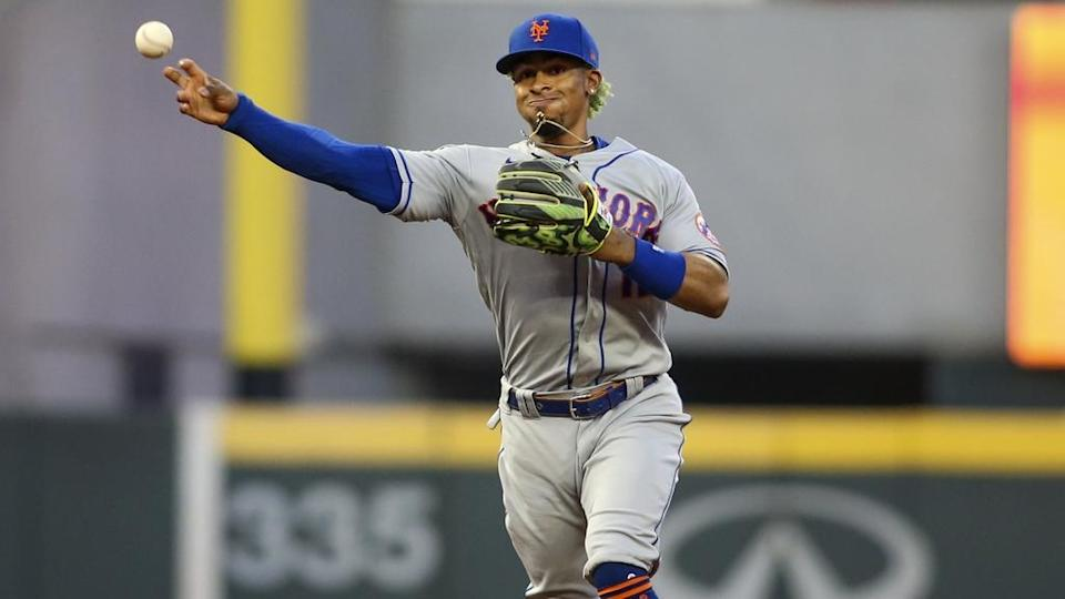 May 19, 2021; Atlanta, Georgia, USA; New York Mets shortstop Francisco Lindor (12) throws a runner out at first against the Atlanta Braves in the fifth inning at Truist Park.