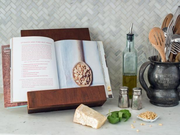 """<p>hgtv.com</p><p><strong>$12.00</strong></p><p><a href=""""https://www.hgtv.com/design/make-and-celebrate/handmade/how-to-make-a-modern-tablet-or-cookbook-stand"""" rel=""""nofollow noopener"""" target=""""_blank"""" data-ylk=""""slk:Shop Now"""" class=""""link rapid-noclick-resp"""">Shop Now</a></p><p>Whether your mom is a master chef or just likes to have cookbooks around the kitchen for decorative purposes, a homemade cookbook stand is a great way to free up some counter space and show off her favorite recipes. </p><p><strong><em>Get the tutorial from <a href=""""https://www.hgtv.com/design/make-and-celebrate/handmade/how-to-make-a-modern-tablet-or-cookbook-stand"""" rel=""""nofollow noopener"""" target=""""_blank"""" data-ylk=""""slk:HGTV"""" class=""""link rapid-noclick-resp"""">HGTV</a>.</em> </strong></p>"""