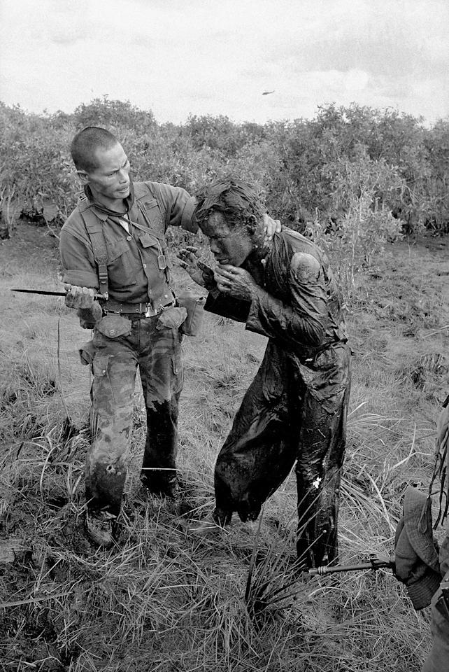 FILE - In this Jan. 9, 1964 file photo one of several shot by Associated Press photographer Horst Faas, earning him the first of two Pulitzer Prizes, a South Vietnamese soldier uses the end of a dagger to beat a farmer for allegedly supplying government troops with inaccurate information about the movement of Viet Cong guerrillas in a village west of Saigon, Vietnam. Faas, a prize-winning combat photographer who carved out new standards for covering war with a camera and became one of the world's legendary photojournalists in nearly half a century with The Associated Press, has died May 10, 2012. He was 79. (AP Photo/Horst Faas, File)