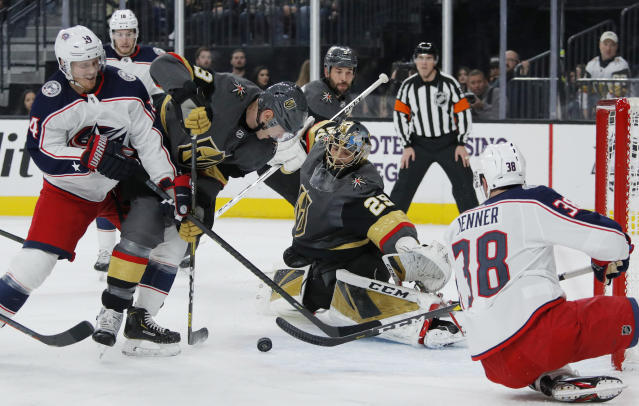 Vegas Golden Knights goaltender Marc-Andre Fleury (29) makes a save against the Columbus Blue Jackets during the first period of an NHL hockey game Saturday, Jan. 11, 2020, in Las Vegas. (AP Photo/John Locher)