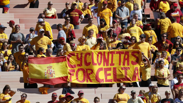 Iowa State fans hold a sign honoring slain student Celia Barquin Arozamena during the second half of an NCAA college football game between Iowa State and Akron, Saturday, Sept. 22, 2018, in Ames, Iowa. Barquin, who was the 2018 Big 12 women's golf champion and Iowa State Female Athlete of the Year, was found Monday morning in a pond at a golf course near the Iowa State campus. (AP Photo/Charlie Neibergall)