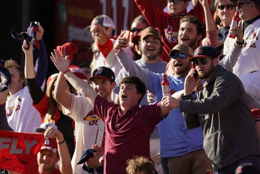 Fans cheer during the fifth inning of Game 2 of the baseball National League Championship Series between the St. Louis Cardinals and the Washington Nationals Saturday, Oct. 12, 2019, in St. Louis. (AP Photo/Charlie Riedel)