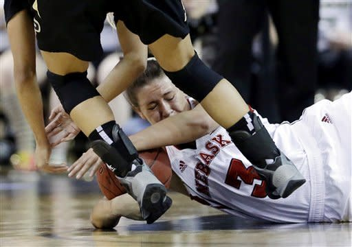Nebraska forward Hailie Sample (3) battles for a loose ball against Purdue guard KK Houser (22) during the first half of an NCAA college basketball game in the Big Ten Conference tournament in Hoffman Estates, Ill., on Saturday, March 9, 2013. (AP Photo/Nam Y. Huh)