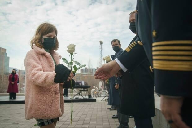 At Thursday's ceremony in Montreal, 10-year-old Brigitte Guérard handed out white roses to the dignitaries on hand.