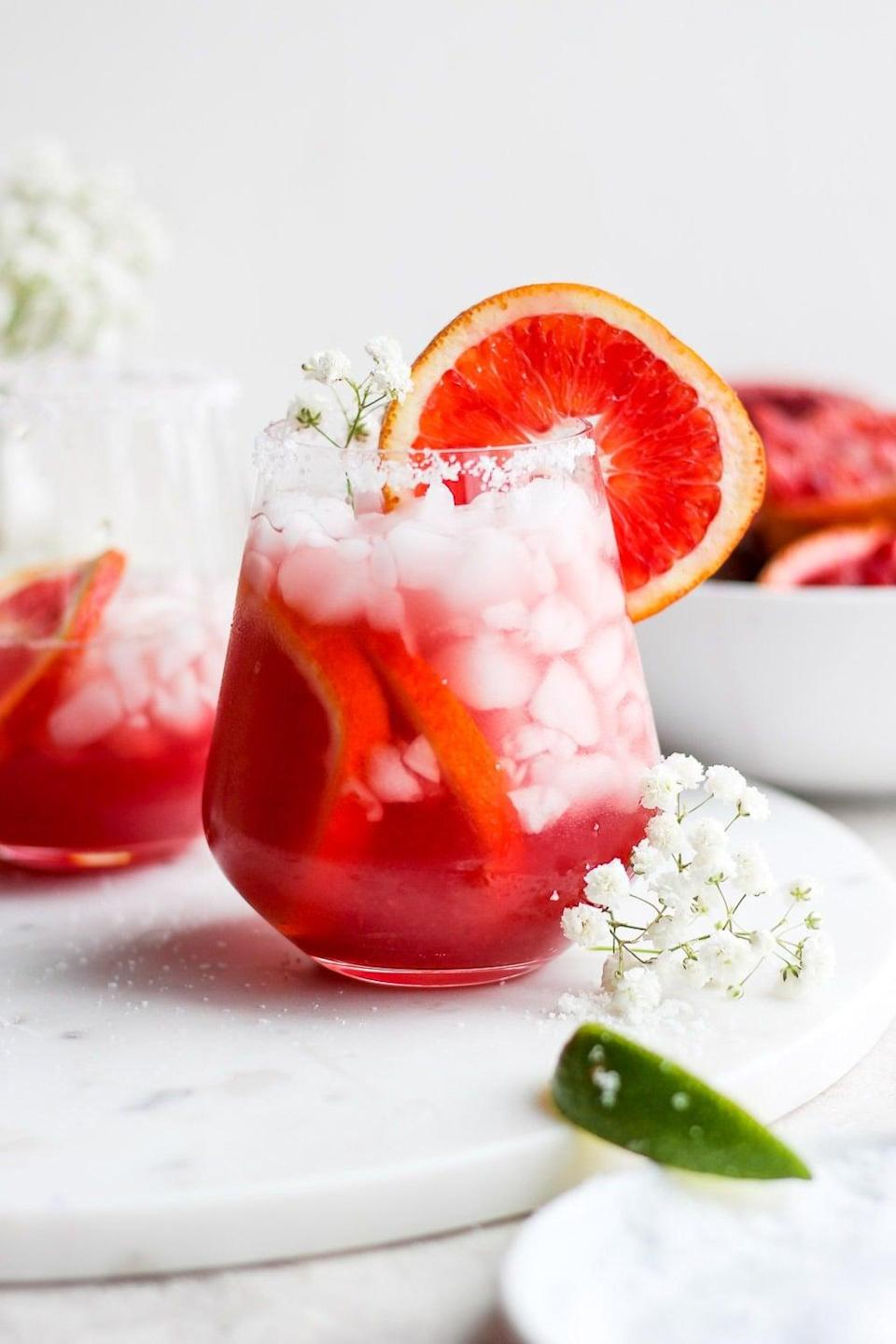 """<p>Give happy hour a whole new meaning when you sip on these blood-orange margaritas. They're easy to make, super refreshing, and unlike any marg you've ever had before.</p> <p><strong>Get the recipe</strong>: <a href=""""https://fitfoodiefinds.com/blood-orange-margarita/"""" class=""""link rapid-noclick-resp"""" rel=""""nofollow noopener"""" target=""""_blank"""" data-ylk=""""slk:blood orange margarita"""">blood orange margarita</a></p>"""