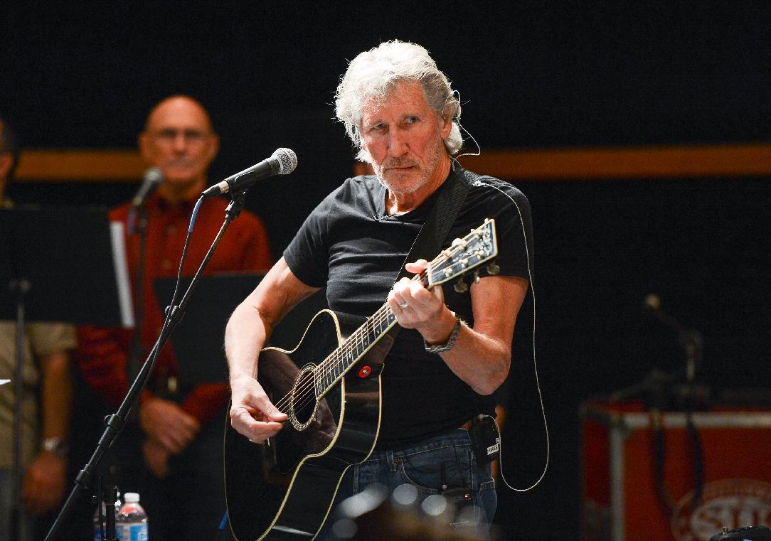 """In this Nov. 4, 2013 file photo, musician Roger Waters and his band hold rehearsals with members of the Wounded Warriors Project for the """"Stand Up For Heroes"""" benefit concert presented by the New York Comedy Festival & the Bob Woodruff Foundation at S.I.R. Studios, in New York. Goldenvoice Entertainment, a subsidiary of AEG Live, announced Tuesday, May 3, 2016, that Paul McCartney,tThe Rolling Stones, Waters, Neil Young, The Who and Bob Dylan will perform for Desert Trip, during a three-day concert, Oct. 7-9, at the desert grounds where the annual Coachella music festival is held in Indio, Calif. (Photo by Evan Agostini/Invision/AP, File)"""