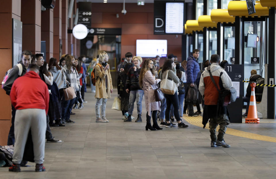Commuters wait for transport at a bus interchange in Christchurch, New Zealand, Monday, June 8, 2020. New Zealand appears to have completely eradicated the coronavirus, at least for now, after health officials said Monday the last known infected person had recovered. (AP Photo/Mark Baker)
