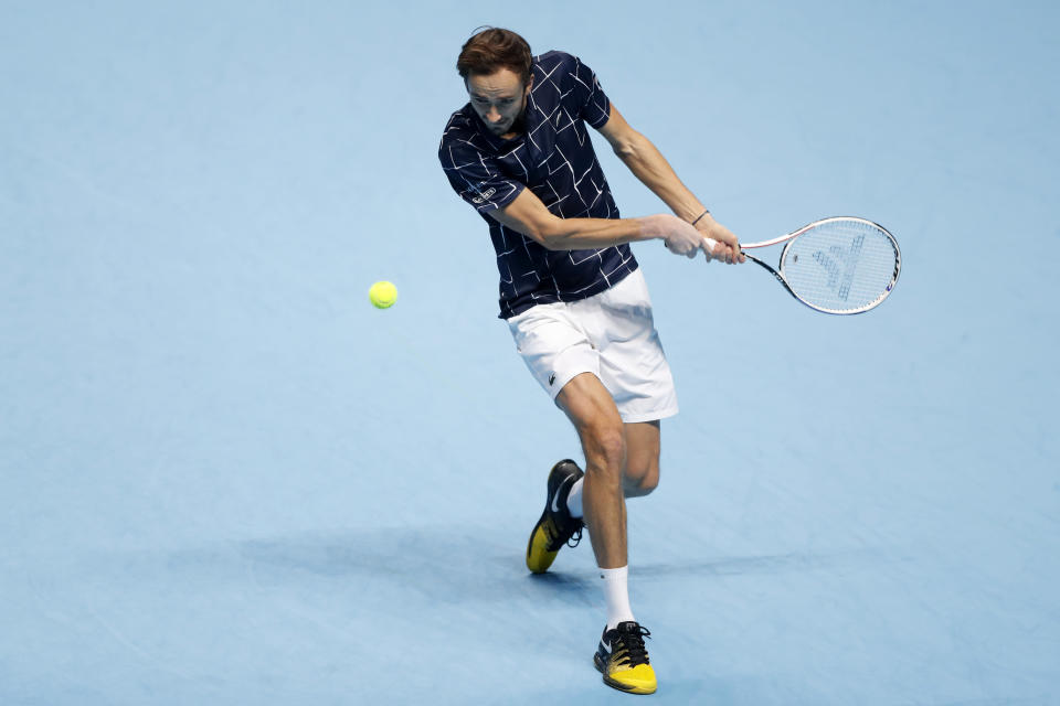 Daniil Medvedev of Russia returns the ball to Rafael Nadal of Spain during their semifinal match at the ATP World Finals tennis tournament at the O2 arena in London, Saturday, Nov. 21, 2020. (AP Photo/Frank Augstein)