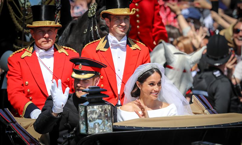 Prince Harry, Duke of Sussex and The Duchess of Sussex ride in the Ascot Landau carriage during the procession after getting married St George's Chapel, Windsor Castle on May 19, 2018 in Windsor, England.