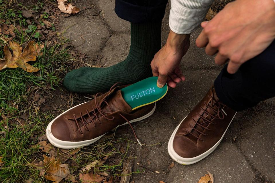 """<h2>Fulton Insoles<br></h2><br>Sure, padding for the inside of your shoe isn't the most glamorous gift — but for years, your mom has sworn by drugstore-bought insoles to ease her foot pain. Why not treat her to a high-end, sustainably made pair that she'd never buy for herself? Fulton's spine-aligning insoles are sustainably made from cactus leather, natural latex, and cork, and offer the gift of engineered arch support every day.<br><br><em>Shop <strong><a href=""""https://walkfulton.com/"""" rel=""""nofollow noopener"""" target=""""_blank"""" data-ylk=""""slk:Fulton"""" class=""""link rapid-noclick-resp"""">Fulton</a></strong></em><br><br><strong>Fulton</strong> Classic Insoles, $, available at <a href=""""https://go.skimresources.com/?id=30283X879131&url=https%3A%2F%2Fwalkfulton.com%2F"""" rel=""""nofollow noopener"""" target=""""_blank"""" data-ylk=""""slk:Fulton"""" class=""""link rapid-noclick-resp"""">Fulton</a>"""