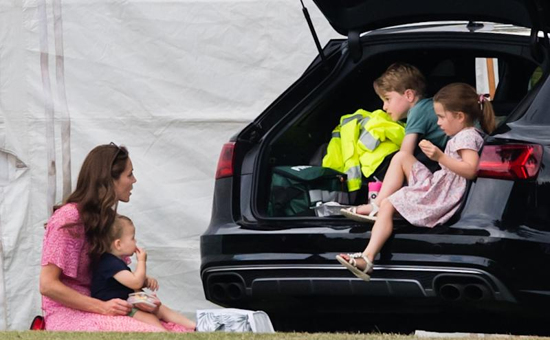 WOKINGHAM, ENGLAND - JULY 10: Catherine, Duchess of Cambridge, Prince Louis, Prince George and Princess Charlotte attend The King Power Royal Charity Polo Day at Billingbear Polo Club on July 10, 2019 in Wokingham, England. (Photo by Samir Hussein/WireImage)