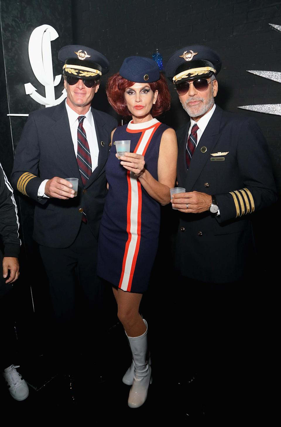 The plane's captains were played by husband Rande Gerber, left, and George Clooney.