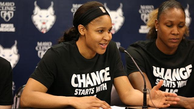 """<a class=""""link rapid-noclick-resp"""" href=""""/wnba/players/4748/"""" data-ylk=""""slk:Maya Moore"""">Maya Moore</a> and her <a class=""""link rapid-noclick-resp"""" href=""""/wnba/teams/min/"""" data-ylk=""""slk:Minnesota Lynx"""">Minnesota Lynx</a> teammates sported T-shirts in support of the Black Lives Matter movement on Saturday night. (David Sherman/Getty Images)"""