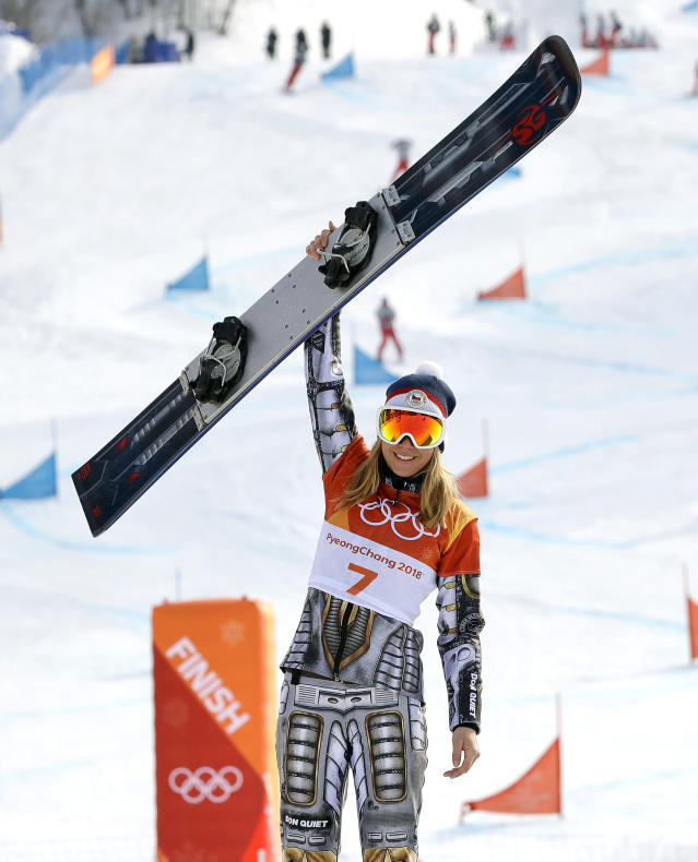 Gold medal winner Ester Ledecka, of the Czech Republic, celebrates after the women's parallel giant slalom at Phoenix Snow Park at the 2018 Winter Olympics in Pyeongchang, South Korea, Saturday, Feb. 24, 2018.(AP Photo/Lee Jin-man)