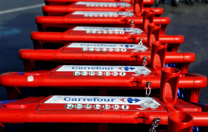 FILE PHOTO: The logo of Carrefour is seen on shopping trolleys at the Carrefour Lingostiere in Nice