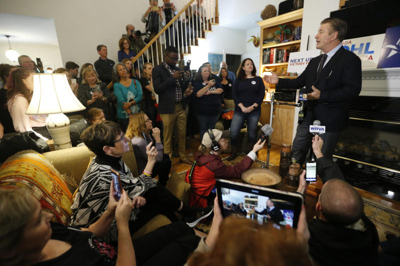 Actor Alec Baldwin, right, talks to a group of supporters of, Amanda Pohl, second from right, candidate for Virginia Senate District 11 in her neighborhood in Midlothian, Va., Tuesday, Oct. 22, 2019. Baldwin campaigned for several candidates around the state. (AP Photo/Steve Helber)