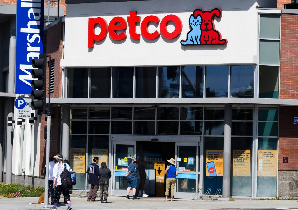 Shoppers wait in a line outside a Petco pet store in Hollywood, California, on April 23, 2020 during the novel coronavirus pandemic. (Photo by Robyn Beck / AFP) (Photo by ROBYN BECK/AFP via Getty Images)