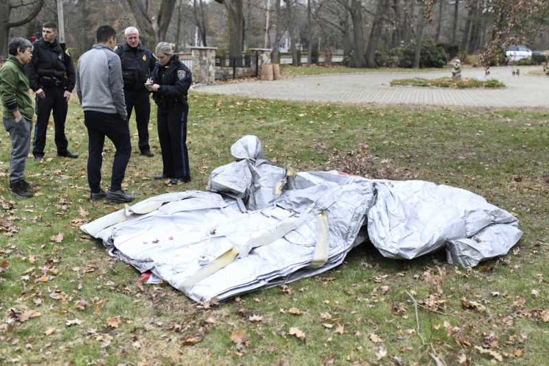Emergency evacuation slide that fell from Delta Air Lines flight and landed in Boston yard.