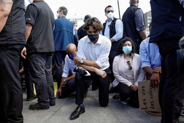 PHOTO: Canada's Prime Minister Justin Trudeau wears a mask as he takes a knee during a rally against the death in Minneapolis police custody of George Floyd, on Parliament Hill, in Ottawa, Ontario, Canada, June 5, 2020. (Blair Gable/Reuters)