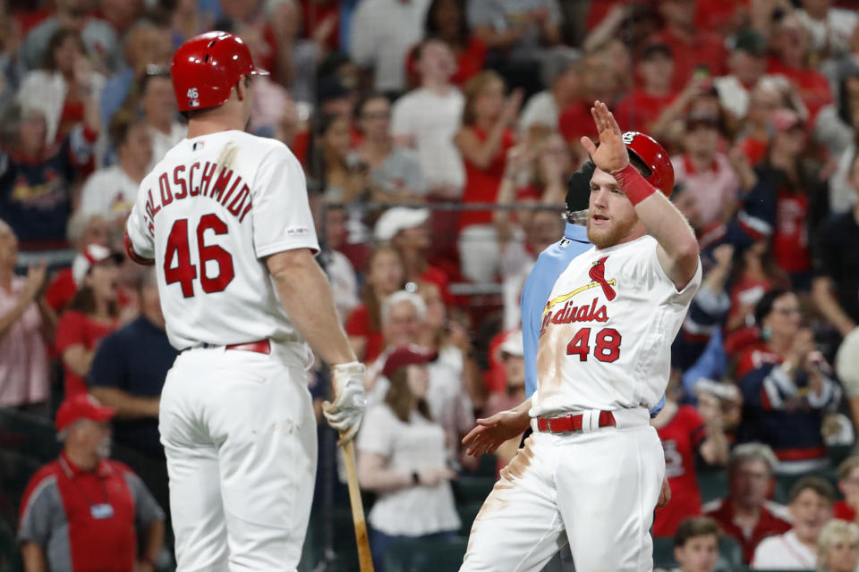 St. Louis Cardinals' Harrison Bader, right, is congratulated by teammate Paul Goldschmidt after scoring during the sixth inning of a baseball game against the Milwaukee Brewers, Friday, Sept. 13, 2019, in St. Louis. (AP Photo/Jeff Roberson)