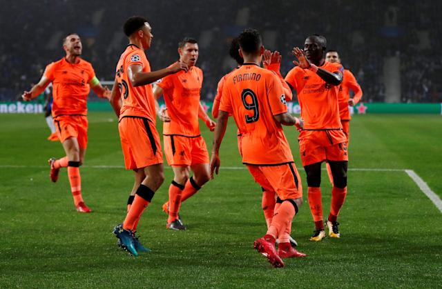 Soccer Football - Champions League Round of 16 First Leg - FC Porto vs Liverpool - Estadio do Dragao, Porto, Portugal - February 14, 2018 Liverpool's Mohamed Salah celebrates scoring their second goal with Roberto Firmino, Sadio Mane and team mates Action Images via Reuters/Matthew Childs