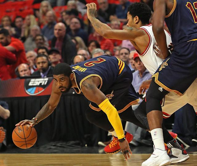 CHICAGO, IL - MAY 08: Kyrie Irving #2 of the Cleveland Cavaliers tries to keep his balance under pressure from Derrick Rose #1 of the Chicago Bulls in Game Three of the Eastern Conference Semifinals of the 2015 NBA Playoffs at the United Center on May 8, 2015 in Chicago, Illinois. (Photo by Jonathan Daniel/Getty Images)