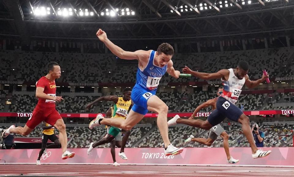 Filippo Tortu of Italy crosses the line to win gold in the 4x100m relay.