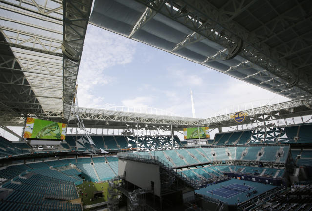 The Miami Open tennis tournament's center court is viewed at Hard Rock Stadium, Monday, March 18, 2019, in Miami Gardens, Fla. The Miami Open has moved north from its home since 1987, the picturesque island of Key Biscayne, and will begin Tuesday at the home of the Miami Dolphins and Miami Hurricanes. (AP Photo/Lynne Sladky)