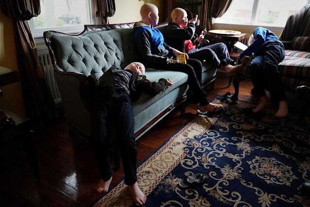 <p>Baraka Lusambo, 7, Pendo Noni 16, Emmanuel Rutema, 15, and Mwigulu Magesaa 14, Tanzanians with albinism who had body parts chopped off in witchcraft-driven attacks, relax after eating a big dinner at a home in the Staten Island borough of New York City, June 4, 2017. (Photo: Carlo Allegri/Reuters) </p>