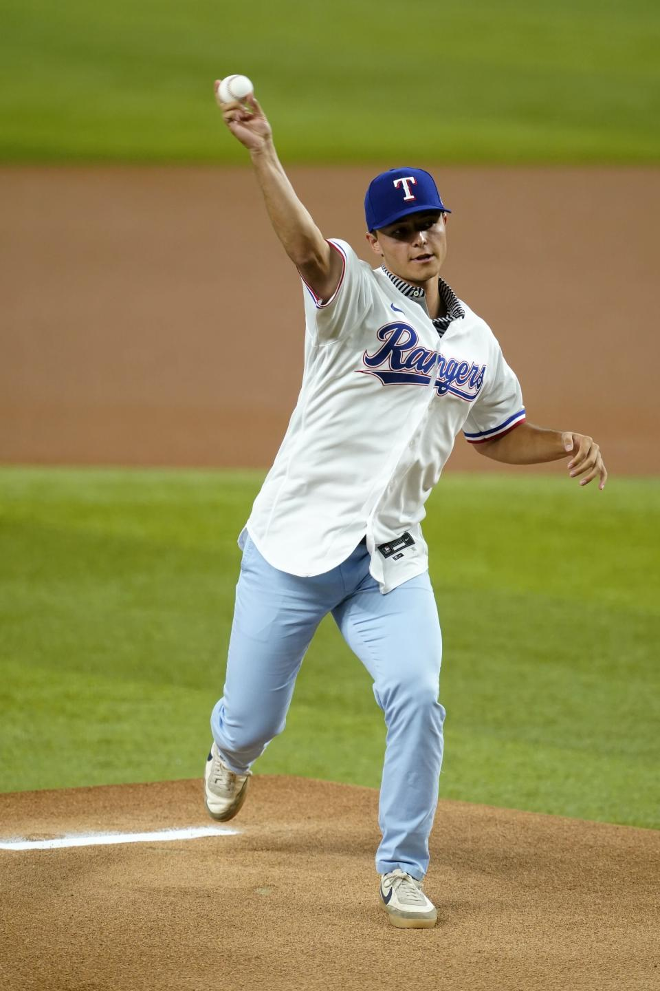 Texas Rangers first-round draft pick Jack Leiter throws out the ceremonial first pitch before the Rangers' baseball game against the Arizona Diamondbacks in Arlington, Texas, Wednesday, July 28, 2021. (AP Photo/Tony Gutierrez)