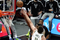 Chicago Bulls forward Patrick Williams, rear, shoots against Milwaukee Bucks center Brook Lopez during the first half of an NBA basketball game in Chicago, Friday, April 30, 2021. (AP Photo/Nam Y. Huh)