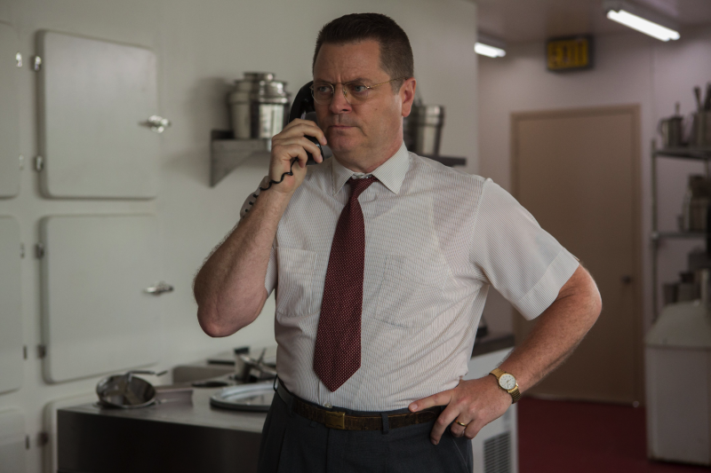 Dick McDonald (Nick Offerman) makes a call in